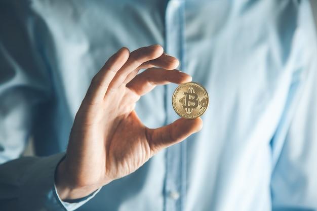 Business man hand bitcoin