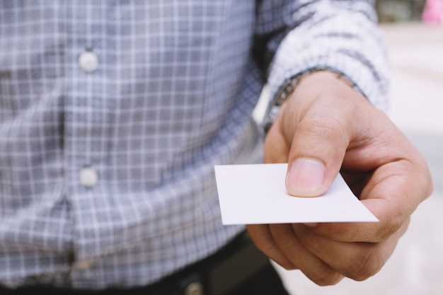 Business man in hand hold show blank white card mock up.