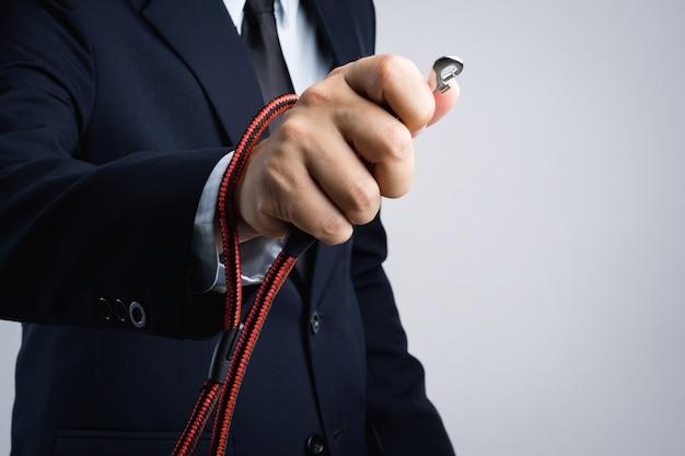 Business man hand holding animal collar strap