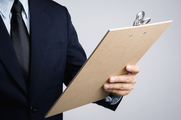Business man hand holding wooden clipboard