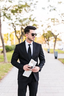 Business man having a walk at the park