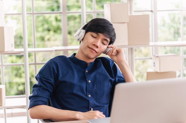 Business man in headphone listening music in office