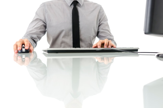 Business man at his desk using computer