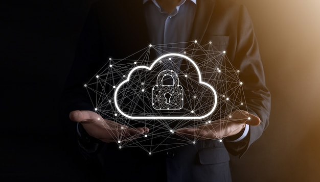 Business man hold,holding cloud computing data and security on global networking,padlock and cloud icon. technology of business.cybersecurity and information or network protection.internet project.