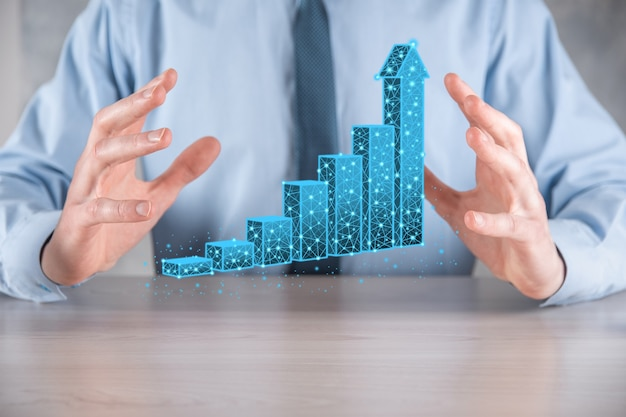 3dグラフの低いポリゴンと株式市場の統計を保持しているビジネスマンは利益を得る。成長計画の概念、ビジネス戦略。経済成長の概念。ビジネス戦略。デジタルマーケティング。