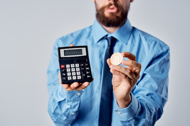 Business man holding a calculator cryptocurrency bitcoin electronic wallet work