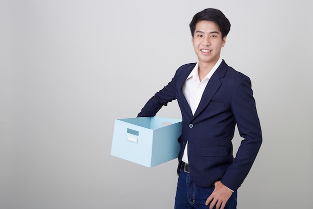 Business man and holding carton box