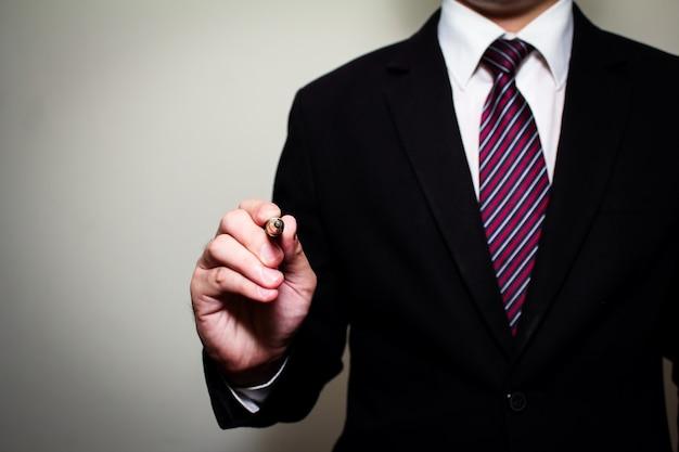 Business man holding fountain pen