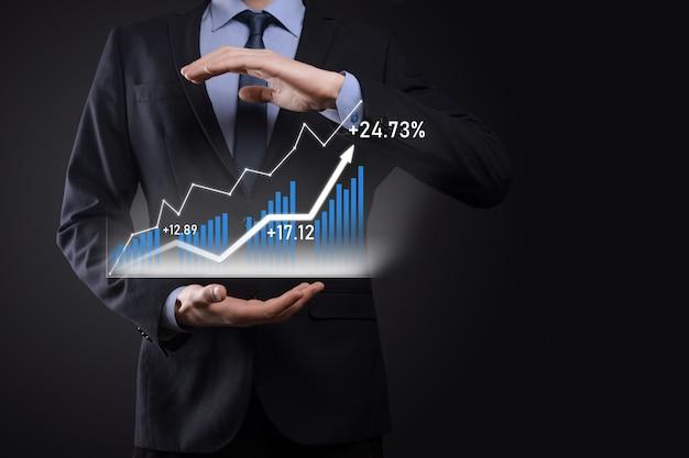 ホログラフィックグラフと株式市場の統計を保持しているビジネスマンは利益を得る