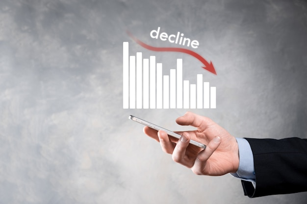 Business man holding holographic graphs and stock.decline, decrease, down, drop. business statistic. career, money, success concept. regression, crisis.business and financial crisis concept