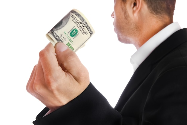 Business man holding money on white surface