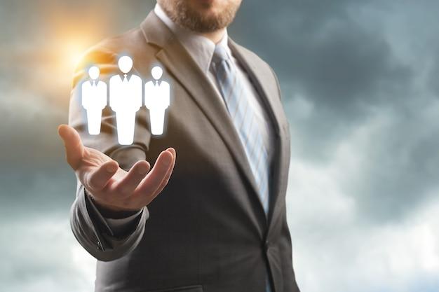 Business man holding opinion leader, team leader, market leader, leading concepts.