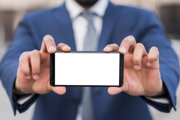 Business man holding phone