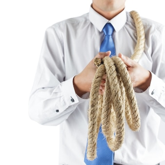 Business man holding rope
