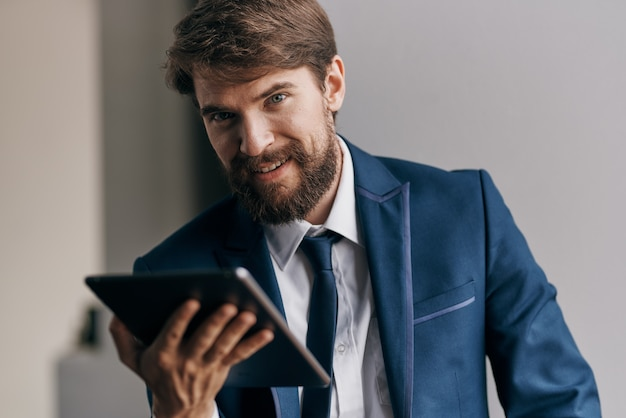 Business man holding a tablet professional executive manager