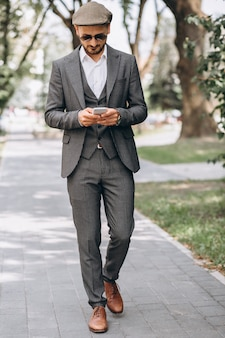 Business man in suit with phone
