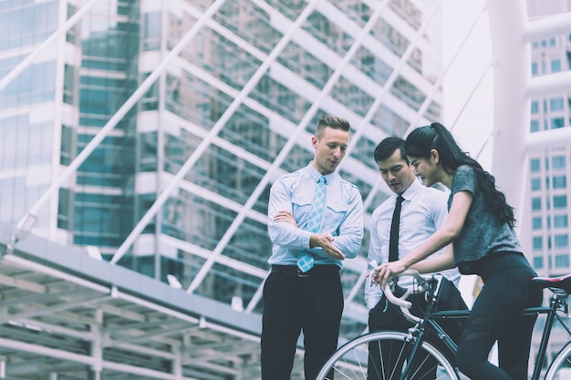 Business man is leading direction for a bicycle sport woman