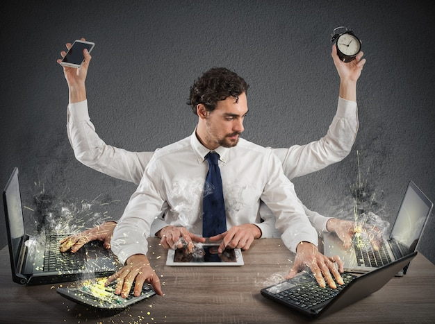Business man performing multiple tasks at the same time