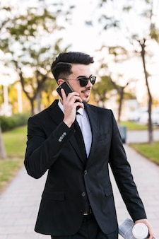 Business man on the phone at the park