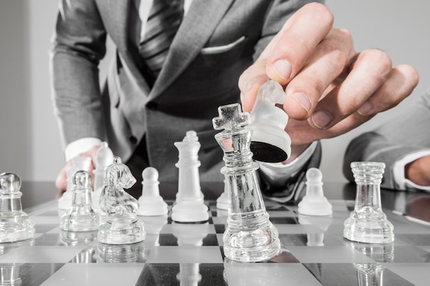 Business man playing chess, business strategy concept