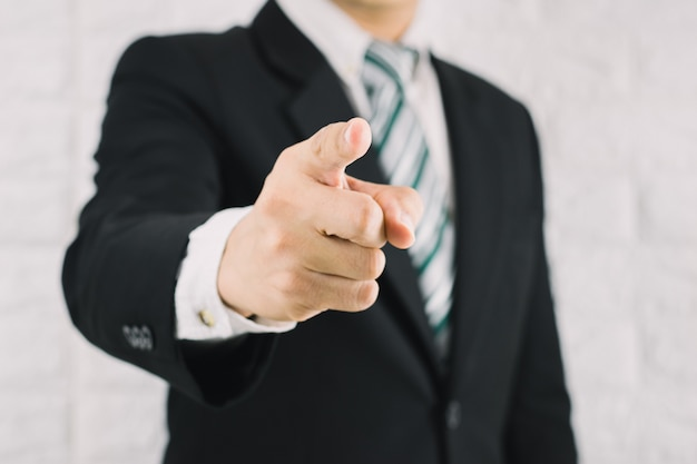 Business man pointing finger of command concept