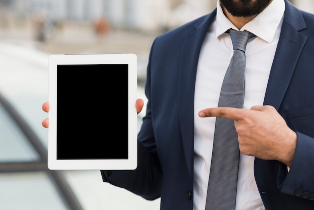 Business man pointing at tablet