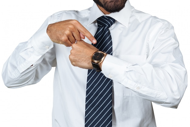 Business man pointing at time on watch