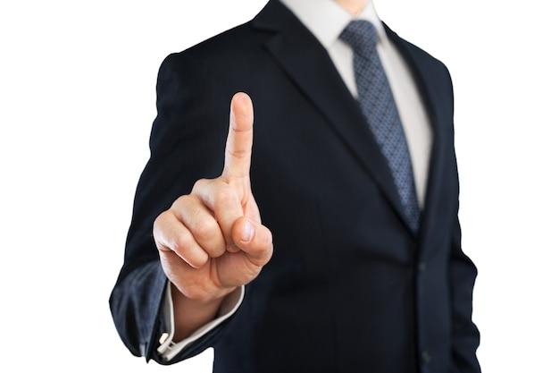 ビジネスマンは彼の指を背景に向けます