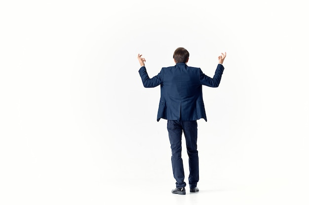 Business man puzzled look light suit gesturing with hands finance and work model