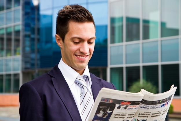 Business man reading a newspaper