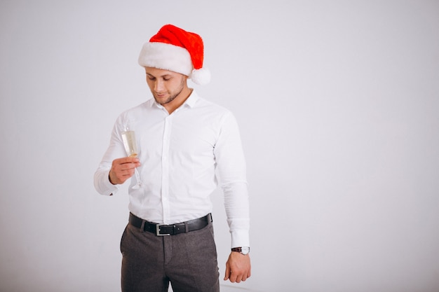 Business man in santa hat with glass of champaigne