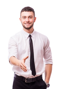Business man saying welcome by giving the hand for shake, focus on hand isolated on white wall