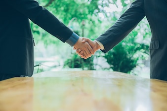 Business man shaking hand after signing contract with cooperator