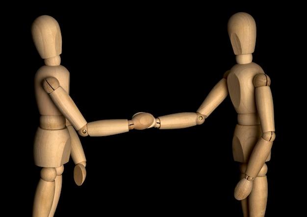 握手するビジネスマン。木製マネキン