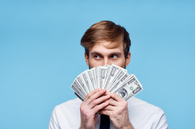 Business man in shirt with tie bundle of money finance. high quality photo