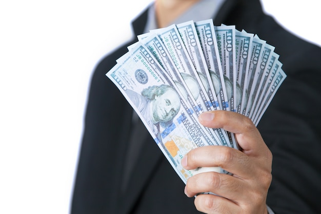 Business man showing cash on hand with white background.