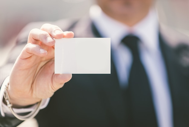 Business man showing his business visit card