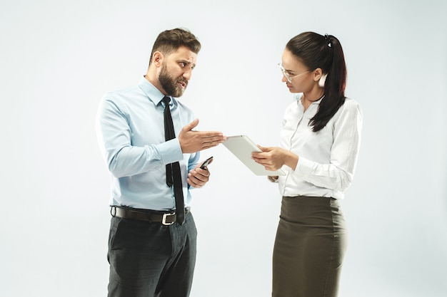 A business man shows the laptop to his colleague in the office