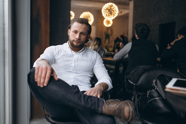 Business man sitting in a chair in a white shirt