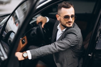 Business man sitting in car