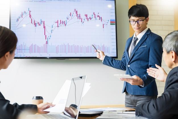 Business man speaker talk stock profit graph presentation meeting office at board