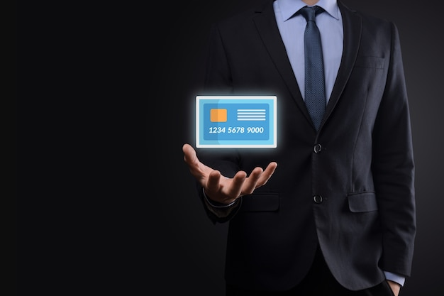 Business man in suit hand holding blank credit card icon showing for concept banking and finance service.