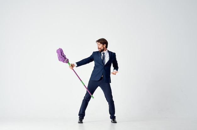 Business man in a suit manager work cleaning with a mop. high quality photo