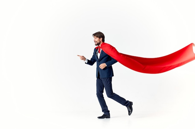 Business man in suit red cloak superhero manager light background