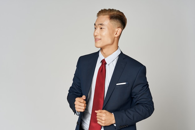 Business man in suit and red tie