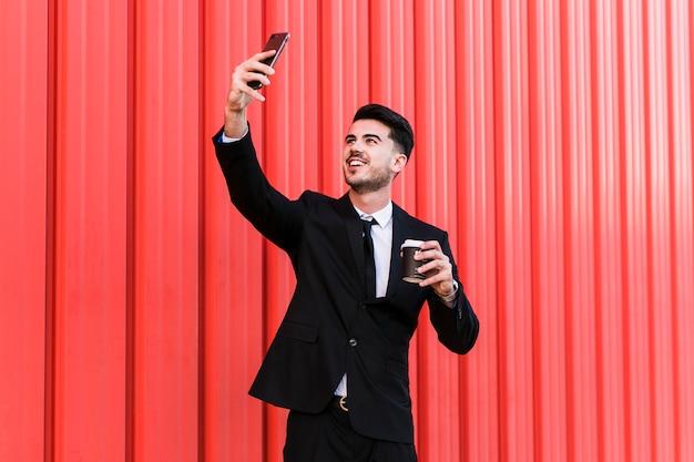 Business man taking a selfie