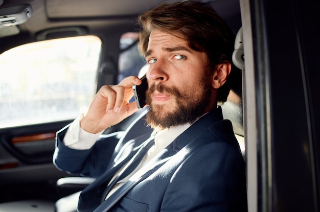 Business man talking on the phone official trip to