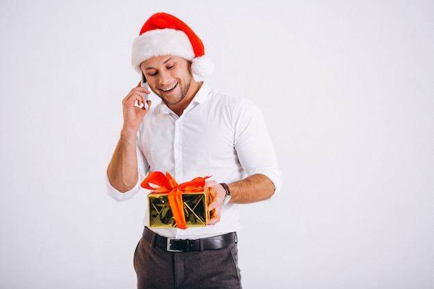 Business man talking on phone in santa hat isolated on white background