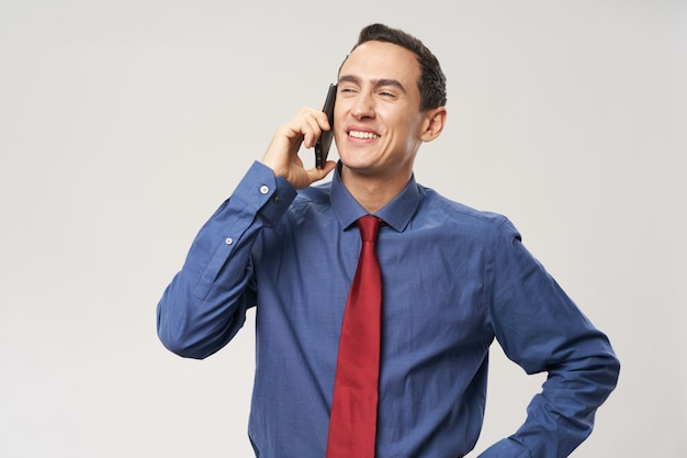 Business man talking on the phone technology office