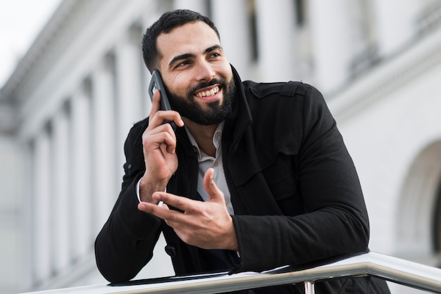 Business man talking over phone